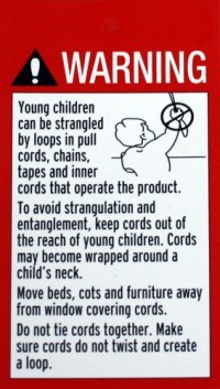 Self-adhesive chain warning sign for Roman blinds etc.
